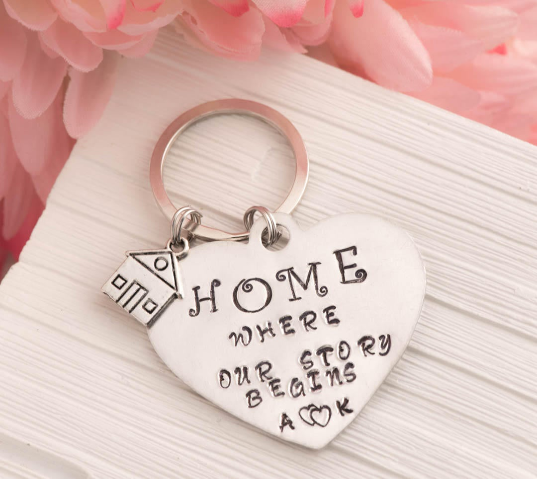 Hand stamped keychain, home is where our story begins engraved keychain